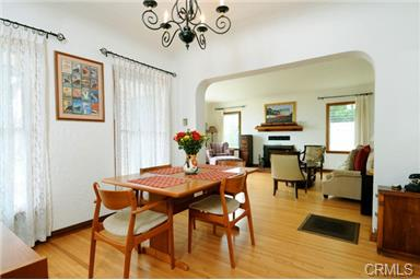Formal dining room also has coved ceilings with two large wood f