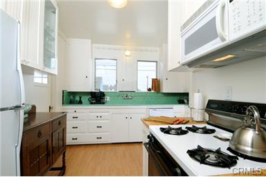 Classic kitchen with glass doors on cupboards to show case your