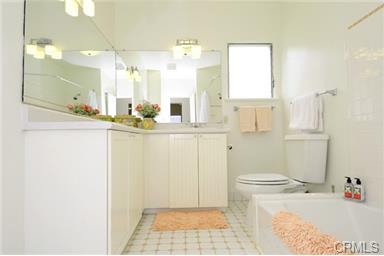 Huge downstairs full bathroom has lots of storage and counter sp